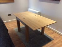 Folding dining table barely used like new. With insurance/warranty included.