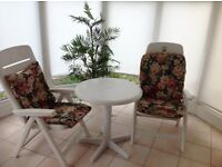 Two Garden/Conservatory chairs and round table.