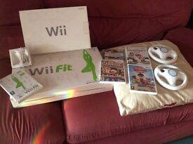Wii Fit fit for sale. No longer needed. Some games to go with it. In good condition