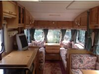 A 1999 Bailey Pageant Champagne, 4/5 berth, end bathroom. Very good condition, with awning. £2200