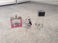 Three empty perfume bottles (matthew Williamson, Gucci & Armani)