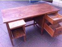 Vintage teacher's desk in good vintage condition. Solid wood. Heavy and sturdy. Lots of storage.