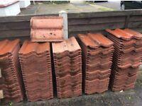 Sandtoft double pantile concrete roof tiles.Terracotta red, interlocking double unit.