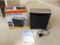 Paper shredder in box with instructions
