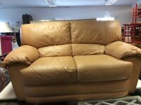 Two seater tan leather sofa plus one armchair