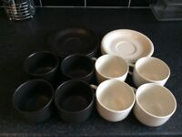 Cups and matching saucers (eight in total, never used). Cheap at £10.