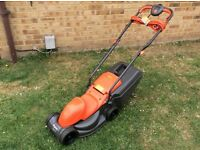 FLYMO EASIMO IN NEAR NEW CONDITION LAWN MOWER