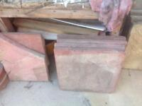 Rose coloured paving slabs