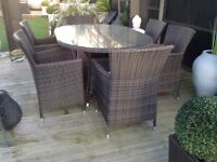 Quality rattan garden patio table and 6 chairs with washable cushions £300 tel 07966921804