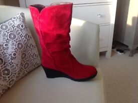 New red suedette boots,