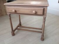 A matching pair of good quality hardwood bed side tables
