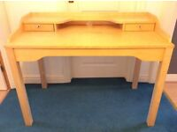 Wooden IKEA computer desk.