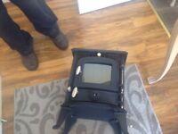 Manufacture Sunrain. Date 08/216 Muti Fuel. 6KW. £130 ONO. Model JA. Cast Iron Tel 07773332418