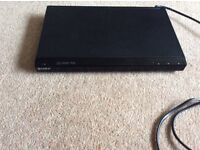 Sony DVD player (Model DVP SR90) with remote control and scart lead. Full working order.