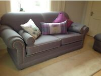 Two immaculate sofas with matching stool
