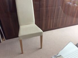 Cream faux leather upright chair with beech legs