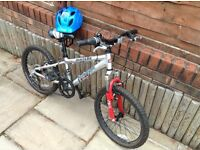 Boys mountain bike with helmet. Would suit 5-10 year old.