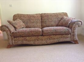 Two sofas and a footstool for sale