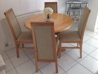kitchendining table and four chairs in beech wood and beige material in excellent condition