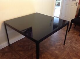 Black Glass top dining table - seats up to 8 people