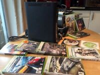 Used XBox 360 Elite, excellent condition full package with 11 games