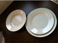 Set of White porcelain plates with rim