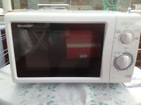 Sharp white 800w microwave oven for sale.