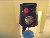 Bedside light for a boy's room space theme, rotating