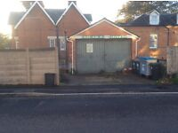 weather proof lockable double garage with space in front