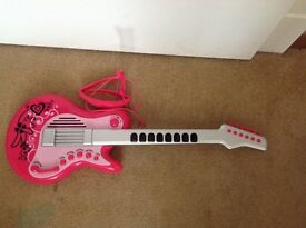Kids guitar with accessory.