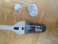 Black and decker cordless vacum cleaner .