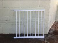 White metal stair gate extension