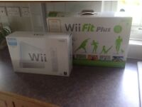 Nintendo Wii fit plus and accessories including 4 games - still boxed - hardly used - as new