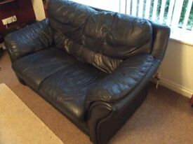 Navy leather suite, 3, 2 And 1 seater (armchair is recliner).