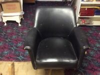 Black leather swivel office chair. Very comfortable, Needs a little attention (paint spillage)