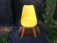 Yellow chair with solid chunky wooden legs for sale