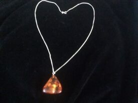 A chunk of amber on a silver chain