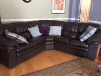 Good condition dark brown real leather corner suite and single chair for sale.