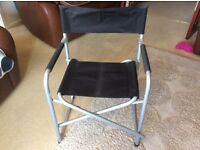 Black Directors chair with sturdy Metal Frame. Never used. Large size and comfortable.