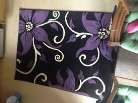 Black, purple and cream rug. 160x120cm. Excellent condition.