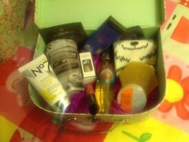 Pamper hamper in floral suitcase. Body Shop, No7, Nails Inc, L'Oreal, plus much more