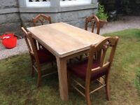Oak dining set with 6 red upholstered chairs
