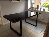 Black metal dining room table with glass top