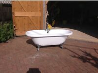 Roll top bath with taps and silver feet