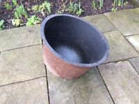 Cast iron couldren can be used as a garden planter