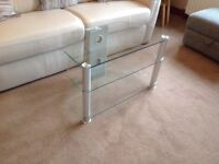 Glass TV stand. 3 tiers angled so fits a corner. In clear glass