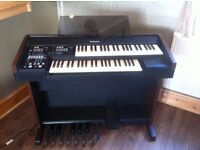 Technics EN1 electronic organ. Great condition, everything works. Stool, dust cover and music rest.