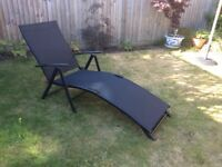 Black adjustable sun lounger hardly used.