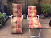 Two White garden reclining chairs