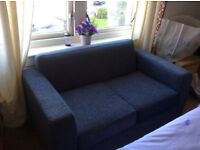 Grey 2 seater unused sofa.